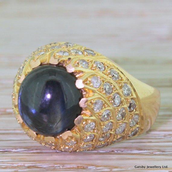 mid century 450 carat cabochon sapphire 038 295 carat diamond bombe ring circa 1965