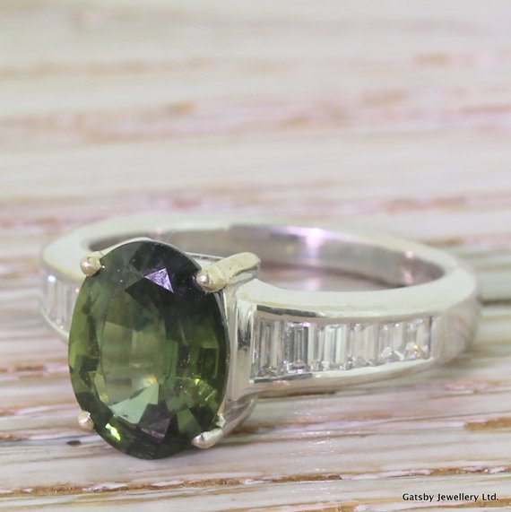 mid century 260 carat green sapphire 038 055 carat baguette cut diamond ring circa 1955