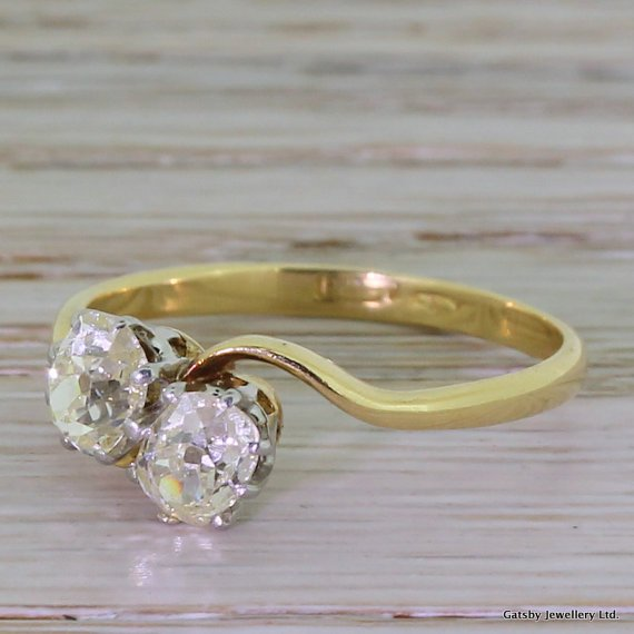 edwardian 110 carat old oval cut diamond crossover ring 18k gold 038 platinum circa 1910