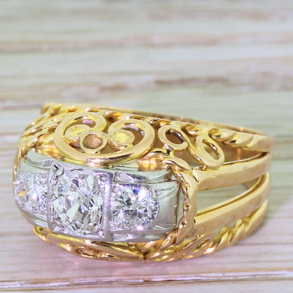 mid century 080 carat old cut diamond ornate trilogy ring circa 1960
