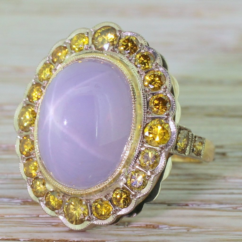 mid century 1510 carat lilac star sapphire 038 fancy yellow diamond cluster ring circa 1960