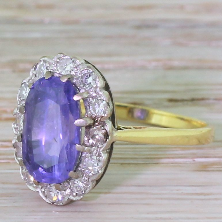 late 20th century 326ct natural purple sapphire 038 diamond cluster ring dated 1974