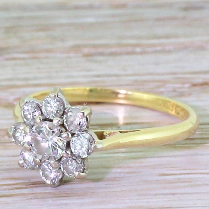 late 20th century 070 carat round brilliant cut diamond daisy ring circa 1970