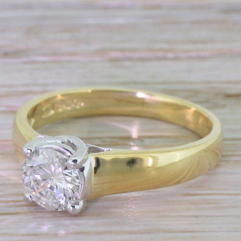 065 carat round brilliant diamond engagement ring 18k yellow gold
