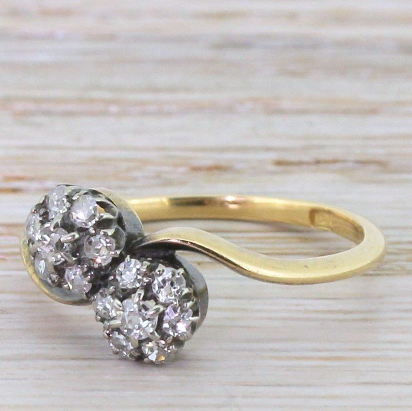 art deco 074 carat old cut diamond double daisy crossover ring circa 1920