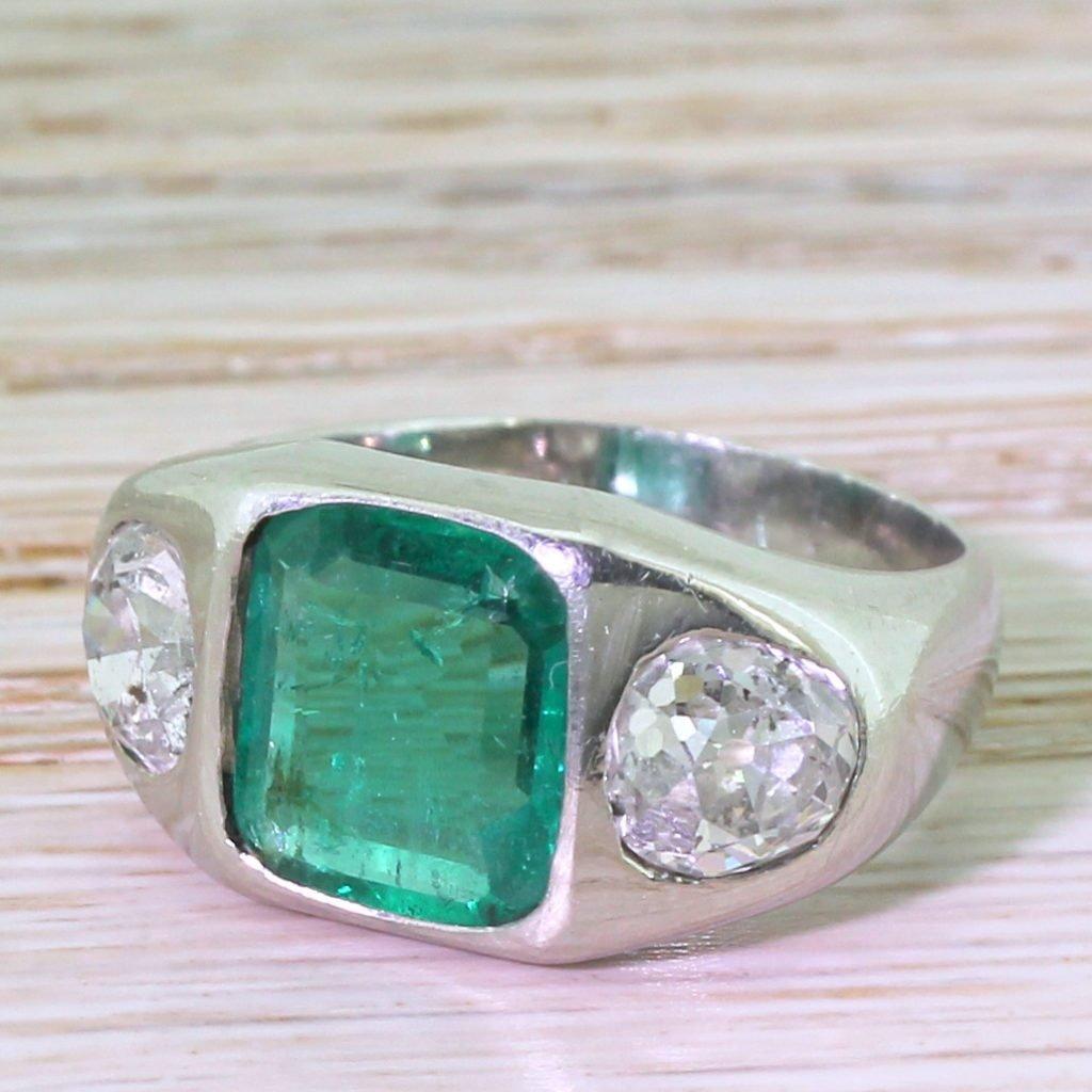 art deco 228 carat emerald 038 197 carat old cut diamond trilogy ring circa 1940