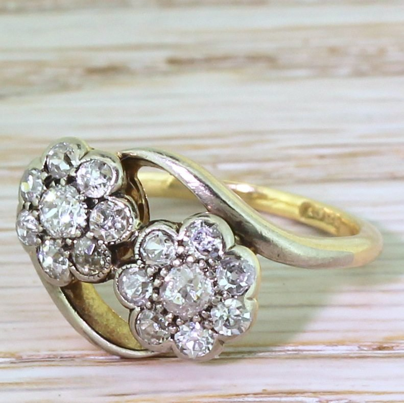 mid century 080 carat old cut diamond double cluster crossover ring circa 1960