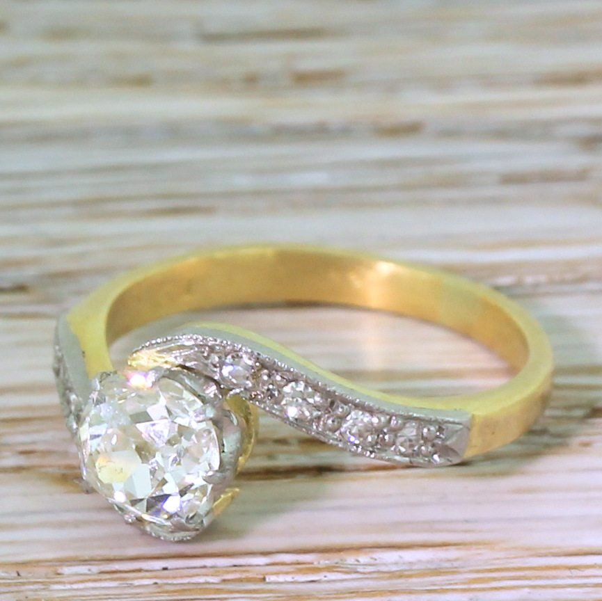 art deco 080 carat old cut diamond crossover engagement ring circa 1930