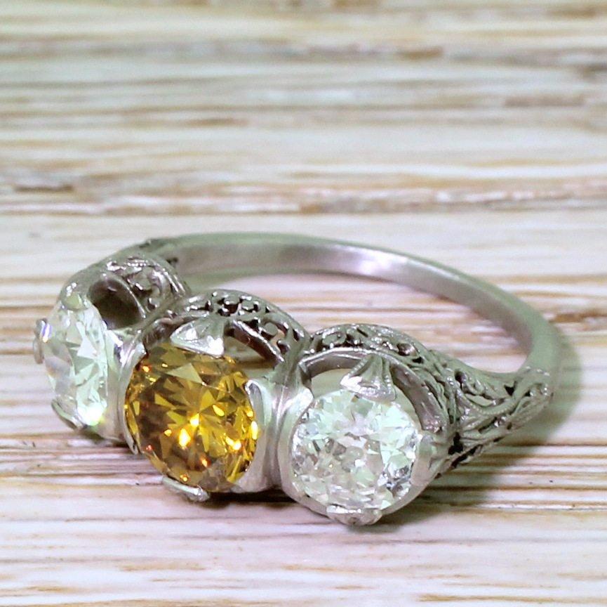 art deco 210 carat fancy intense yellow 038 white diamond trilogy ring circa 1925