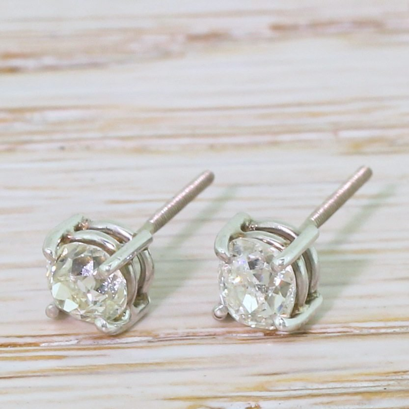 106 carat old mine cut diamond stud earrings 18k white gold