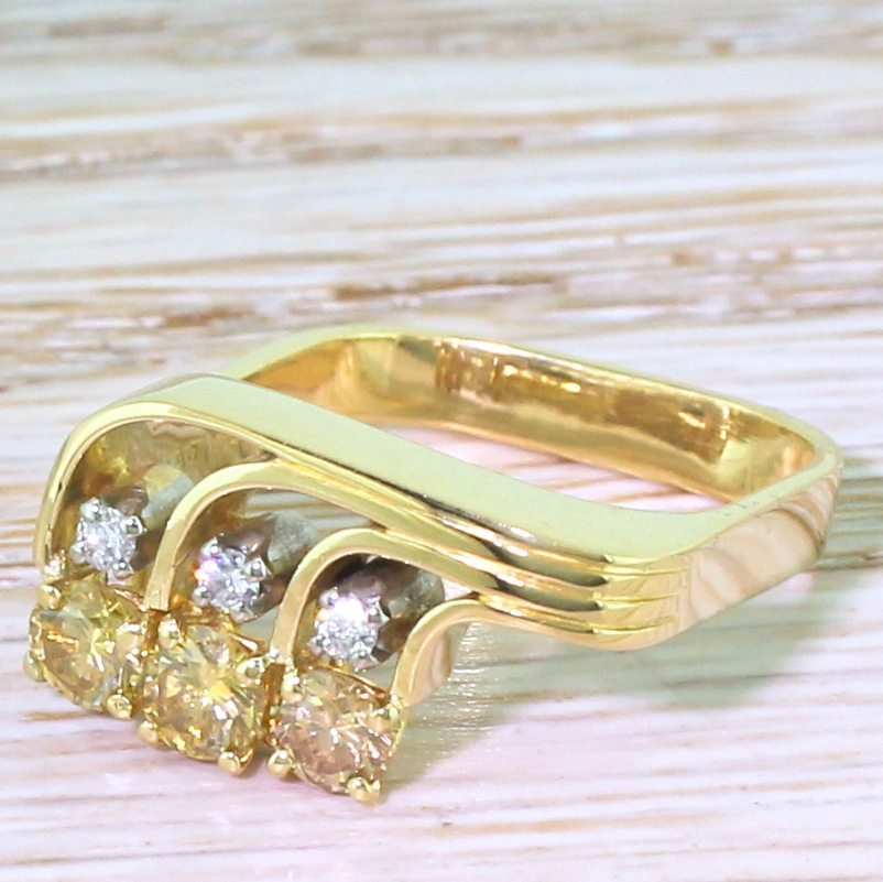 modernist fancy deep yellow 038 white brilliant cut diamond trilogy ring dated 1978