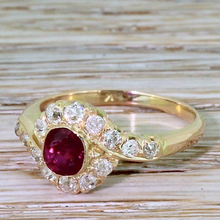 edwardian 055 carat ruby 038 060 carat old cut diamond cluster ring circa 1910