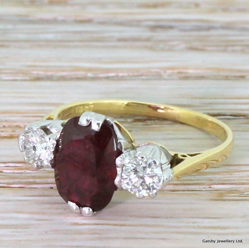 mid century 213 carat ruby 038 050 carat diamond trilogy ring dated 1971