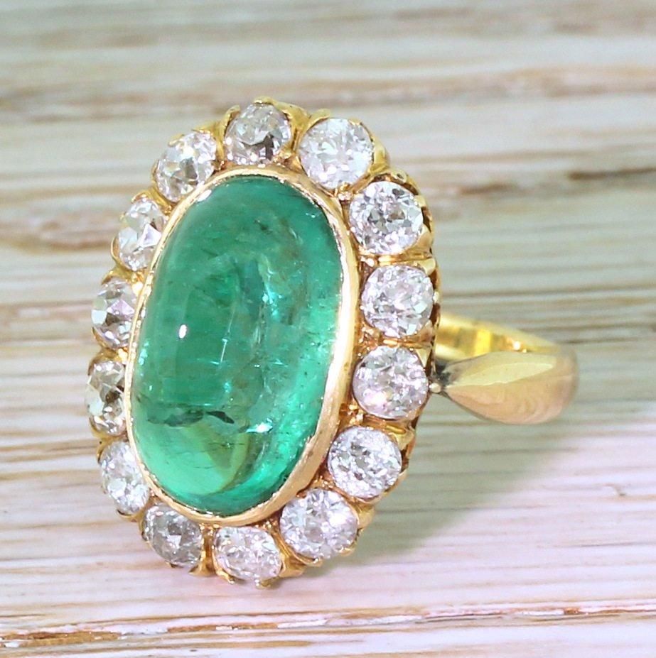 art deco 643 carat colombian cabochon emerald 038 diamond coronet cluster ring circa 1920