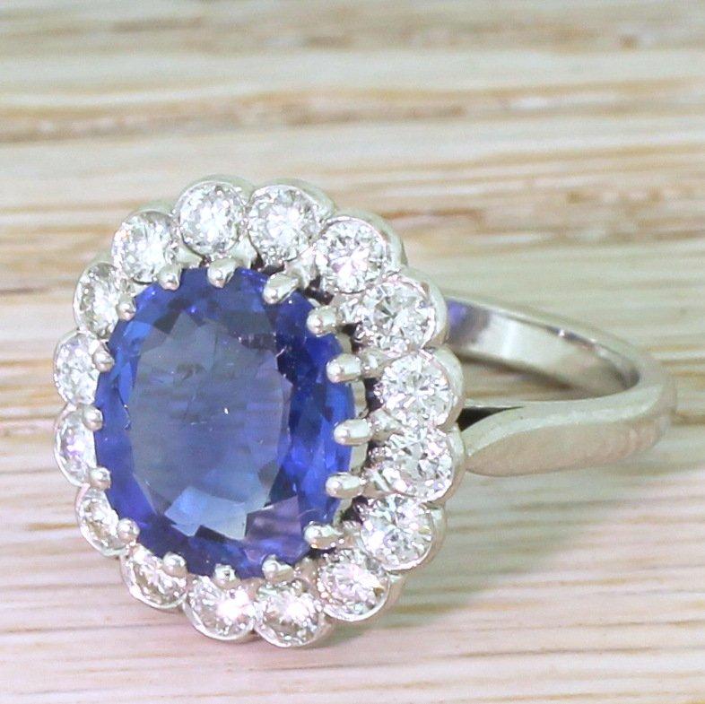 late 20th century 444 carat natural burmese sapphire 038 diamond cluster ring circa 1980