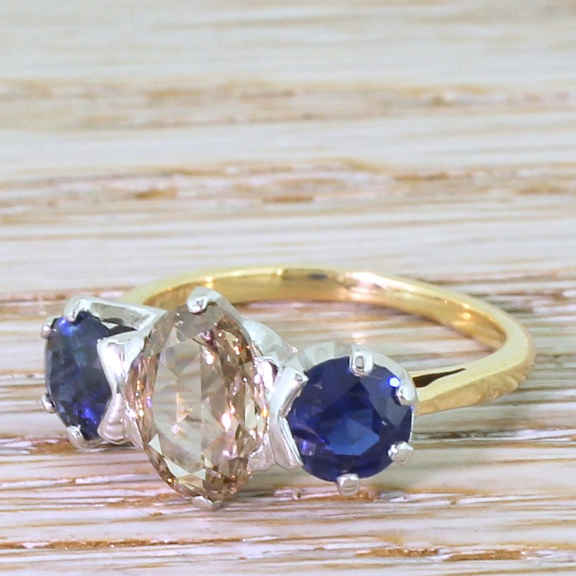 mid century 146 carat fancy intense brown diamond 038 sapphire trilogy ring circa 1955