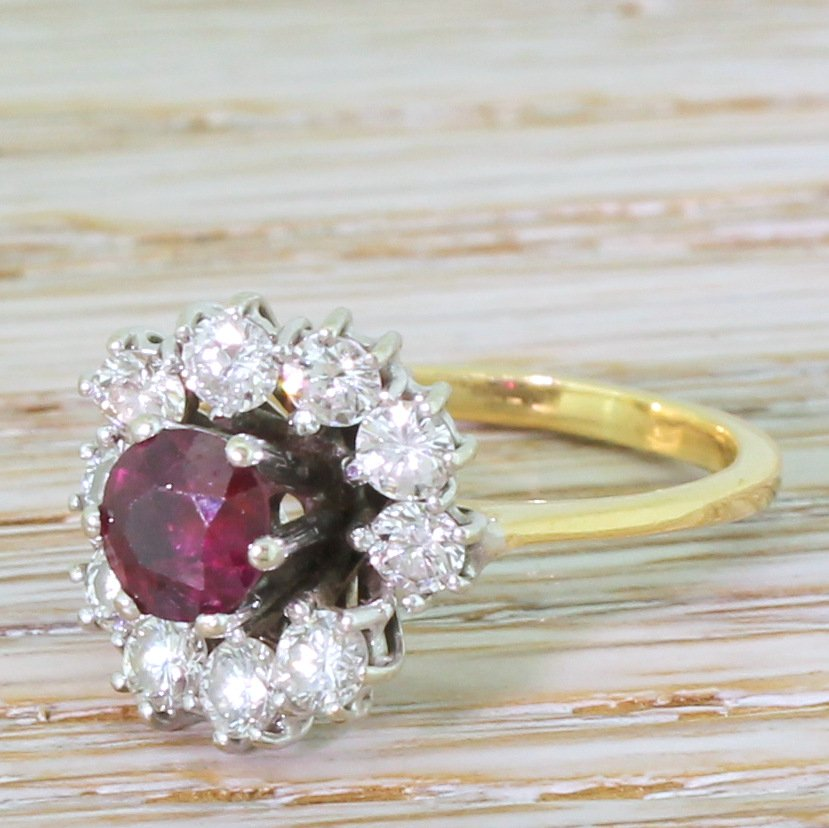 late 20th century 063 carat ruby 038 075 carat diamond cluster ring circa 1970