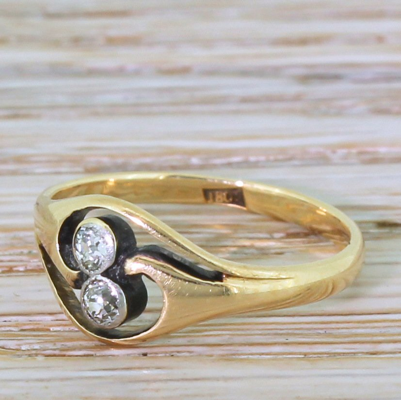art nouveau 020 carat old cut diamond two stone twist ring circa 1905