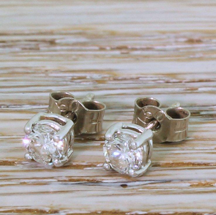 060 carat round brilliant cut diamond stud earrings 18k white gold