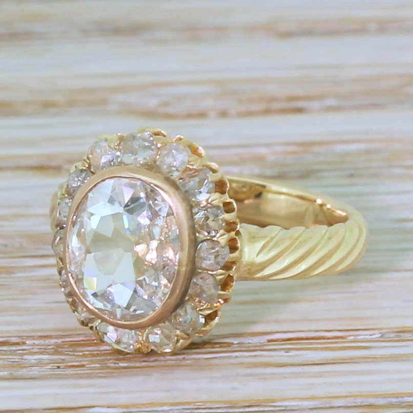 mid century 124 carat old oval cut diamond cluster ring circa 1950