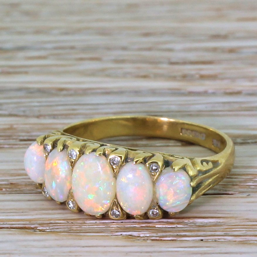125 carat opal carved half hoop ring 18k gold