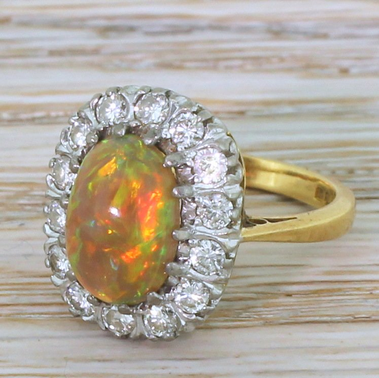 late 20th century 173 carat natural opal 038 diamond cluster ring dated 1972
