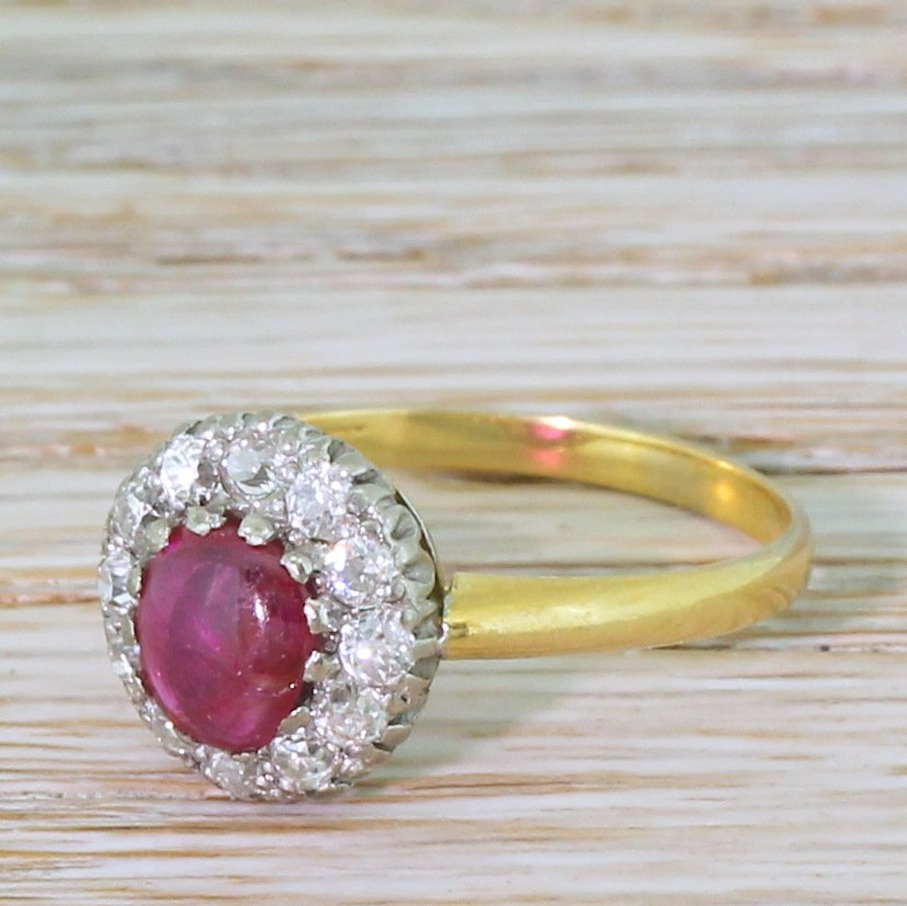 mid century 065 carat cabochon ruby 038 old cut diamond cluster ring circa 1950
