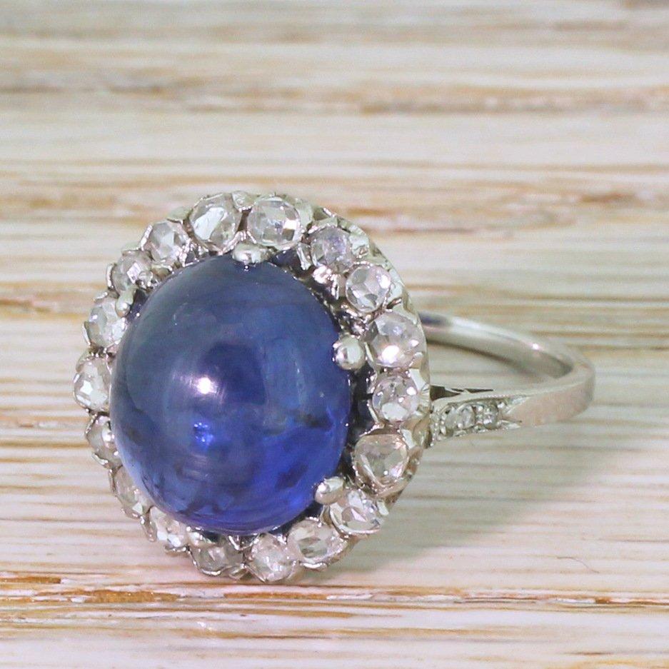 mid century 920 carat cabochon sapphire 038 rose cut diamond cluster ring circa 1950