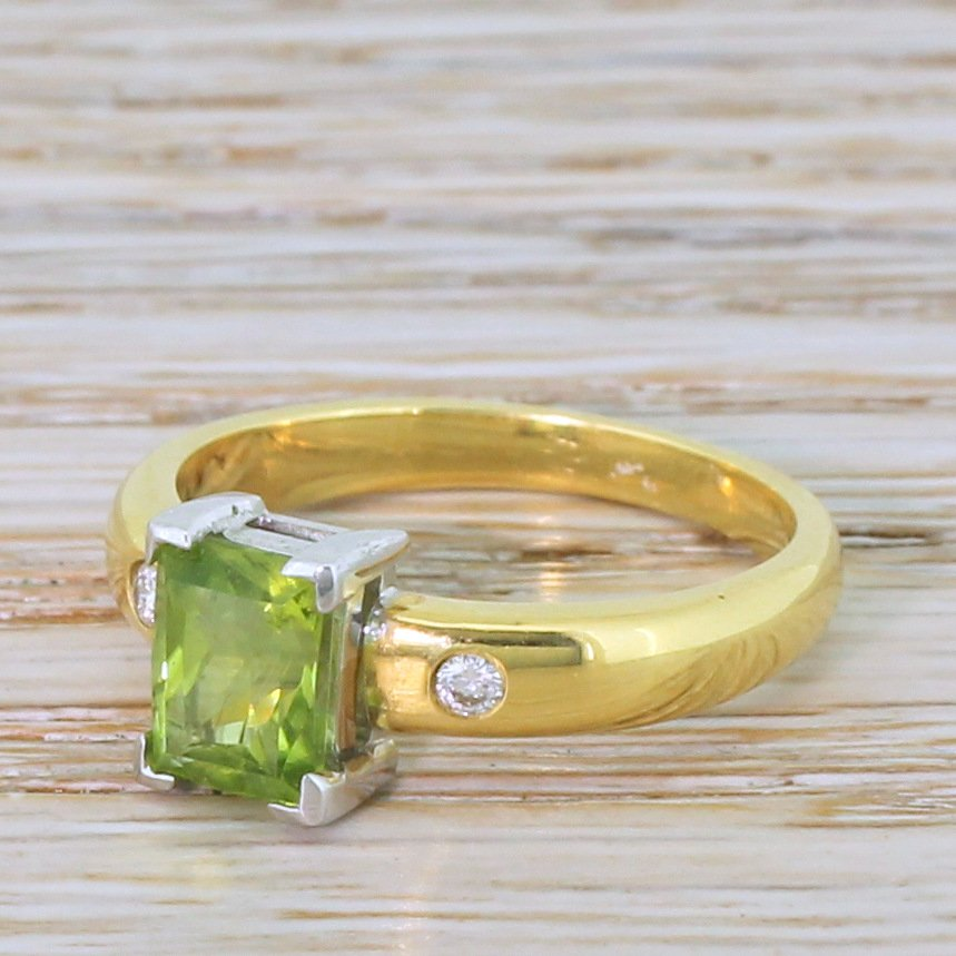 145 carat rectangular mixed cut peridot solitaire ring 18k gold