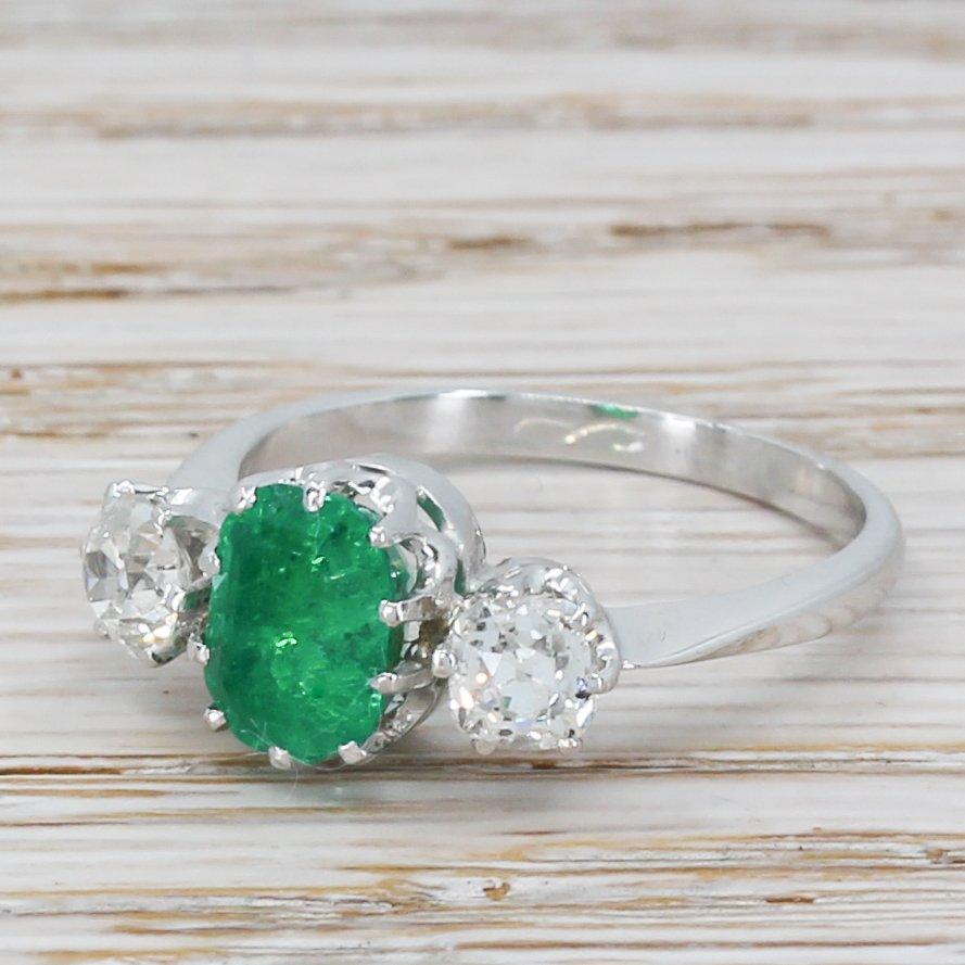 mid century 156 carat emerald 038 078 carat diamond trilogy ring circa 1955