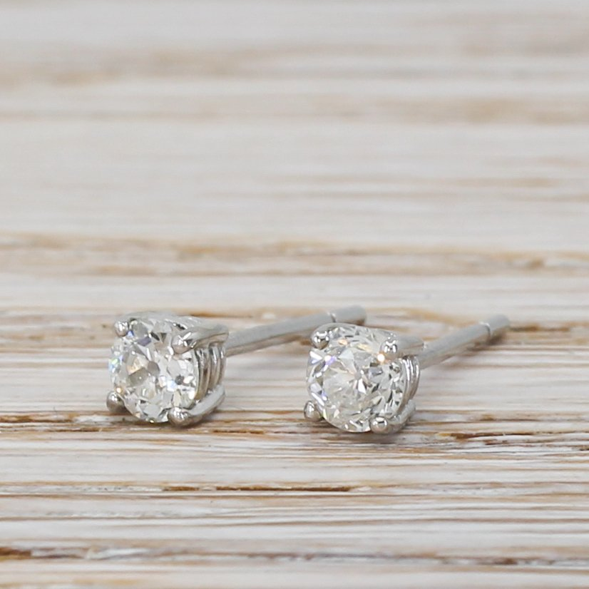 050 carat old cut diamond stud earrings 18k white gold