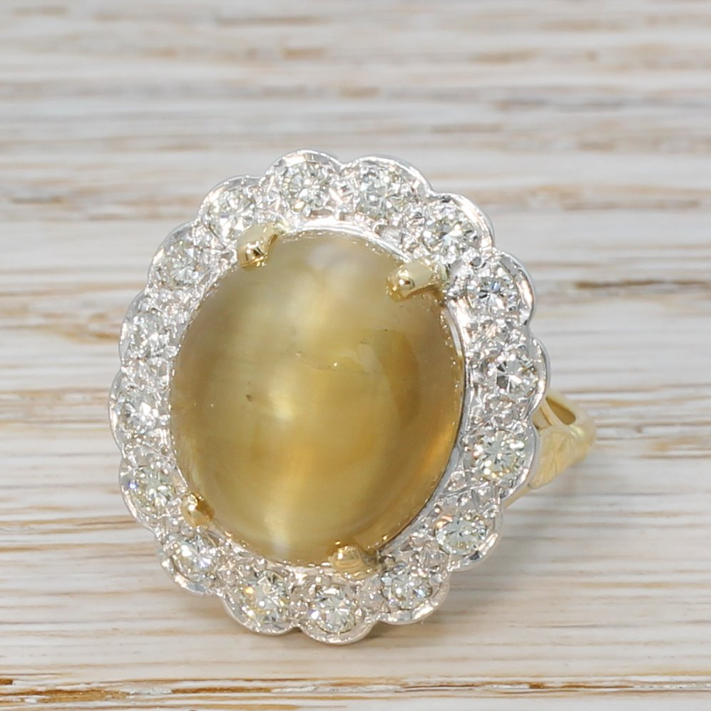 mid century 1731 carat cat8217s eye chrysoberyl 038 diamond cluster ring circa 1965