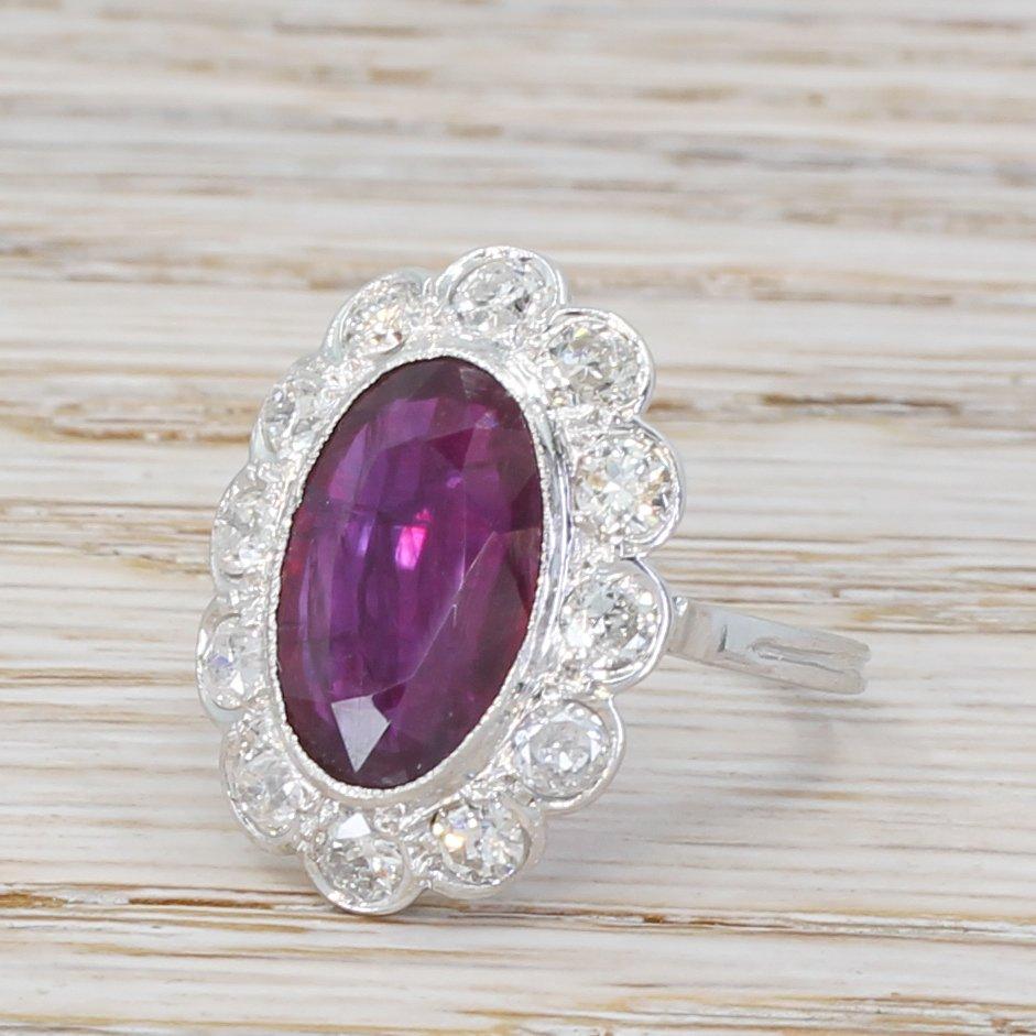mid century 384 carat ruby 038 148 carat diamond cluster ring circa 1960