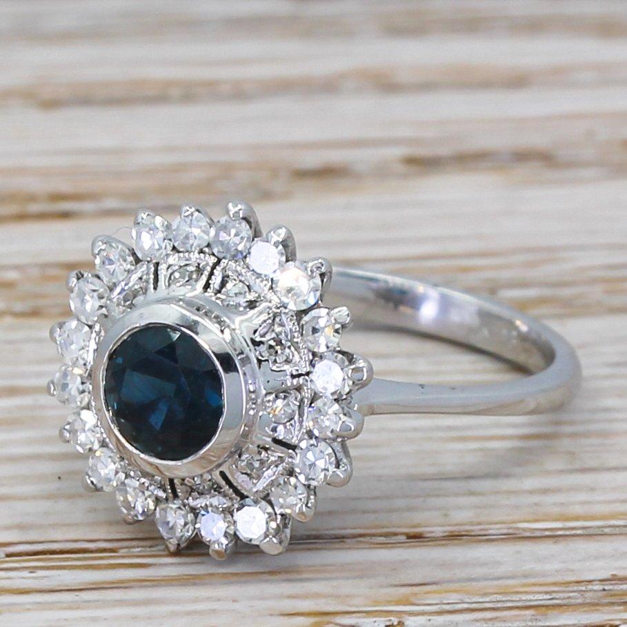 mid century 091 carat sapphire 038 diamond cluster ring circa 1970