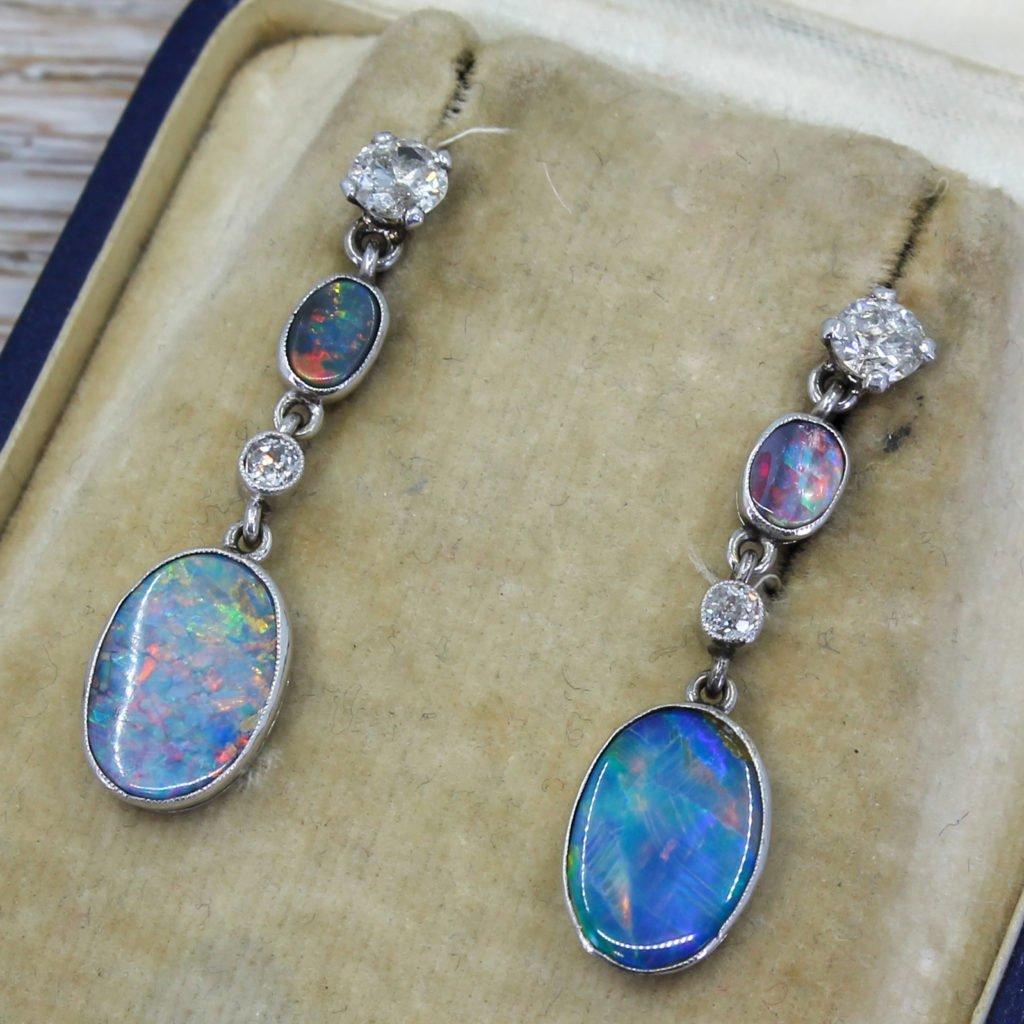 mid century 150 carat black opal 038 091 carat diamond drop earrings circa 1960