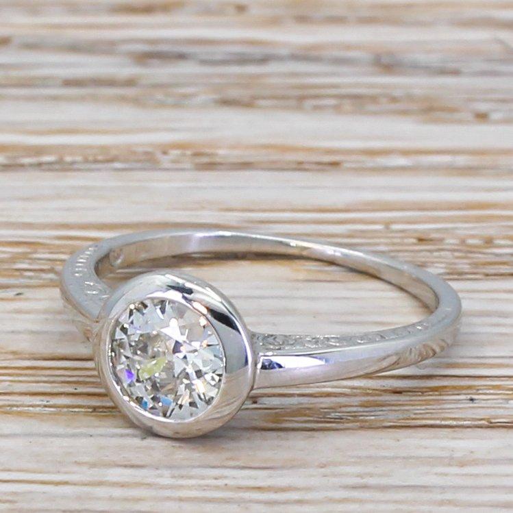 mid century 071 carat old cut diamond engagement ring circa 1960