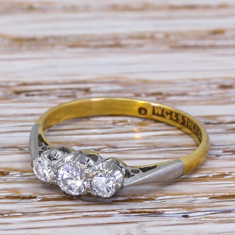 mid century 025 carat round brilliant cut diamond trilogy ring circa 1965