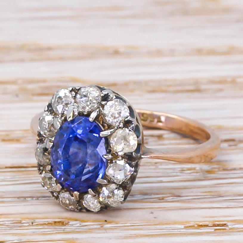 mid century 181 carat sapphire 038 diamond cluster ring circa 1950