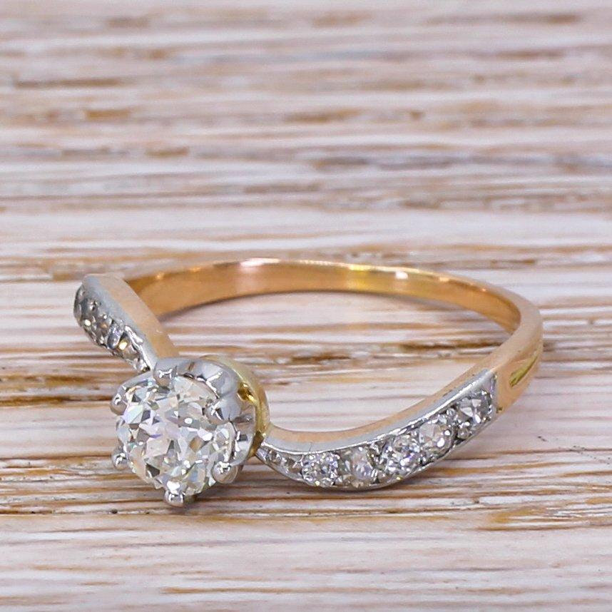 edwardian 077 carat old cut diamond curved engagement ring circa 1910