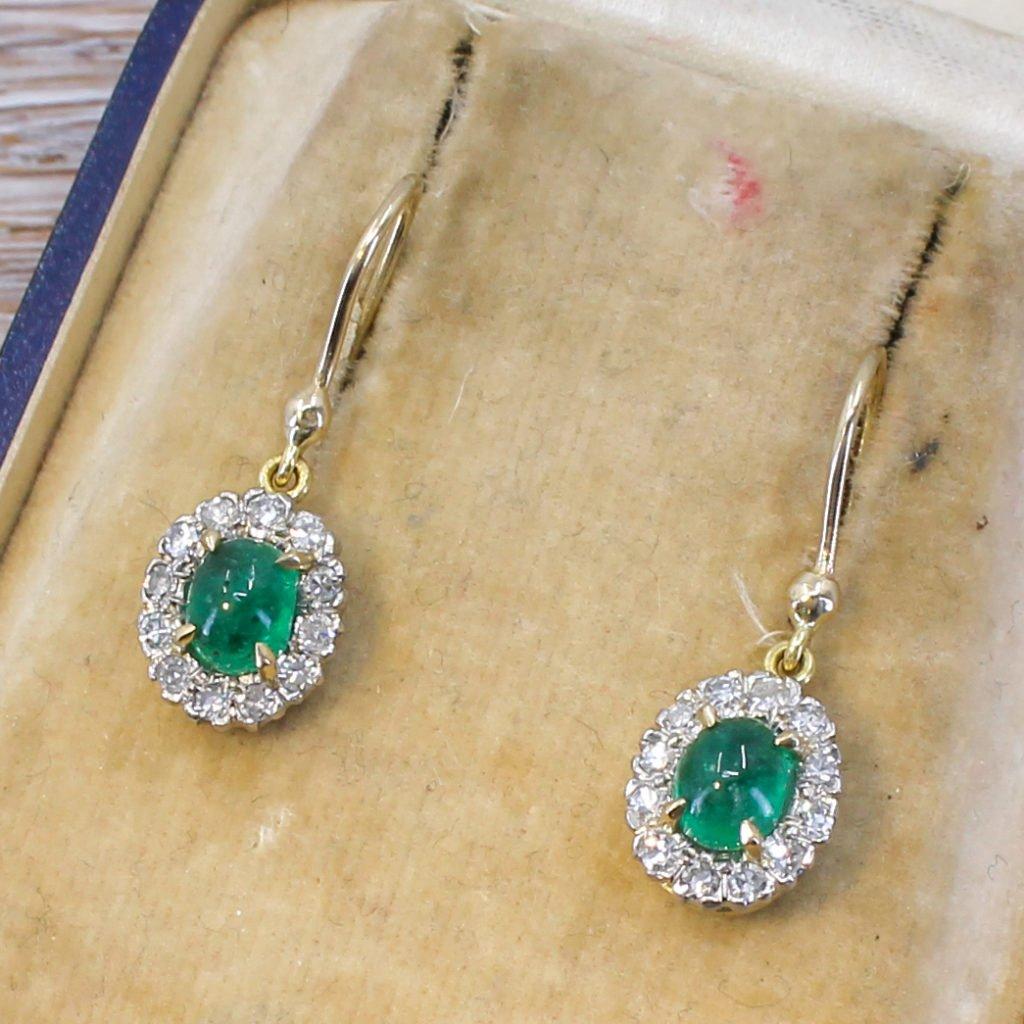 art deco 148 carat cabochon emerald 038 diamond earrings circa 1930